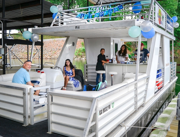 Party boat with custom hand painted watercolor banners