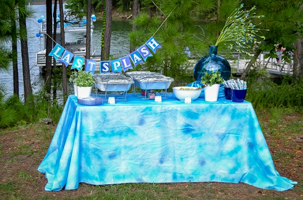 Buffet set up. Custom banner and tablecloth, hand painted watercolor food labels. Individually wrapped silverware with hand painted watercolor sleeves.